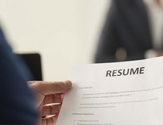 Person holding a resume