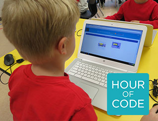 Kid playing a coding game on a computer